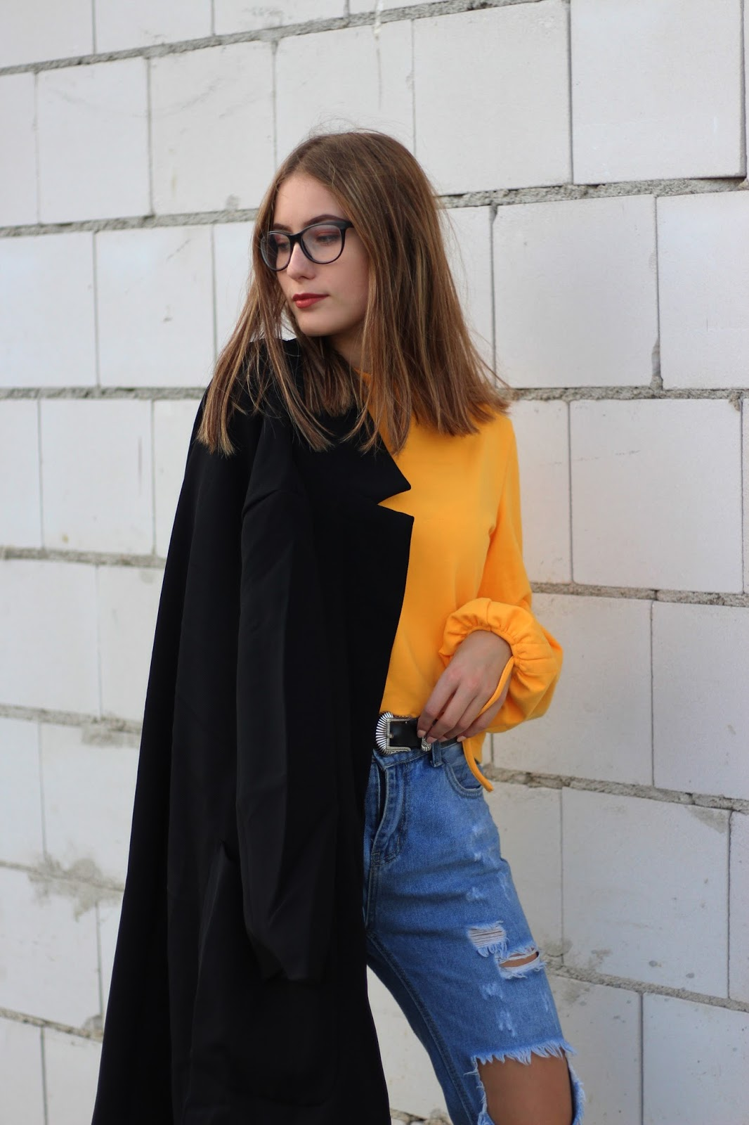 jeans and yellow sweatshirt