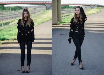 The world is my runway.: Cut out black sweater.