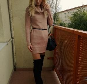 Madeleine Styles: Beige turtleneck and black thigh boots